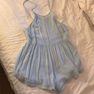 blue romper with white ladder detail